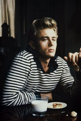 Thoughtful and contemplative James Dean is photographed below while having breakfast around 1954-1955