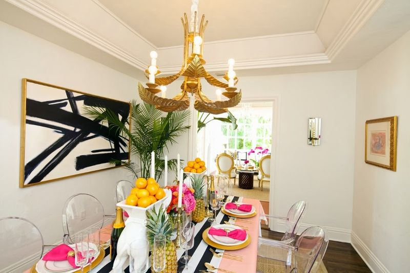 Lucite-gost-chairs-palm-chandelier-chic